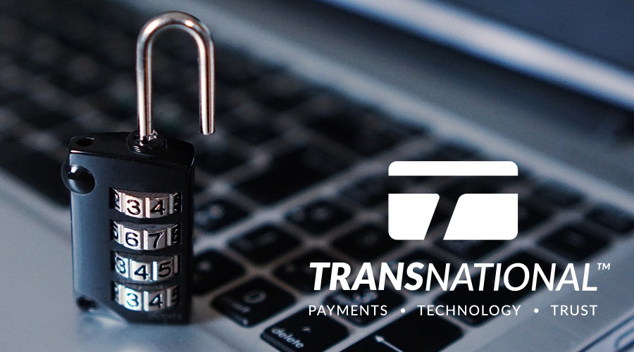 Digital combination padlock next to the laptop and the TransNational Payments logo