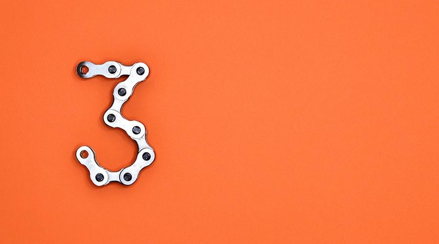 Metallic number three on the orange background
