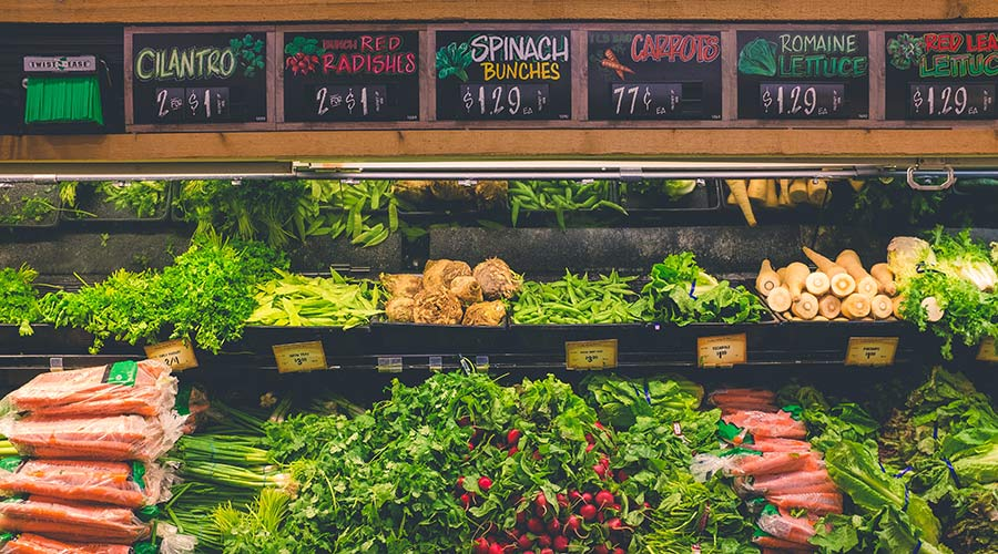 Fresh produce displayed on the stand at a grocery store