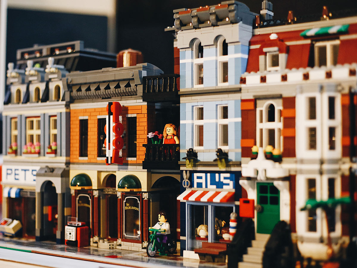 Street with small business buildings made out of lego