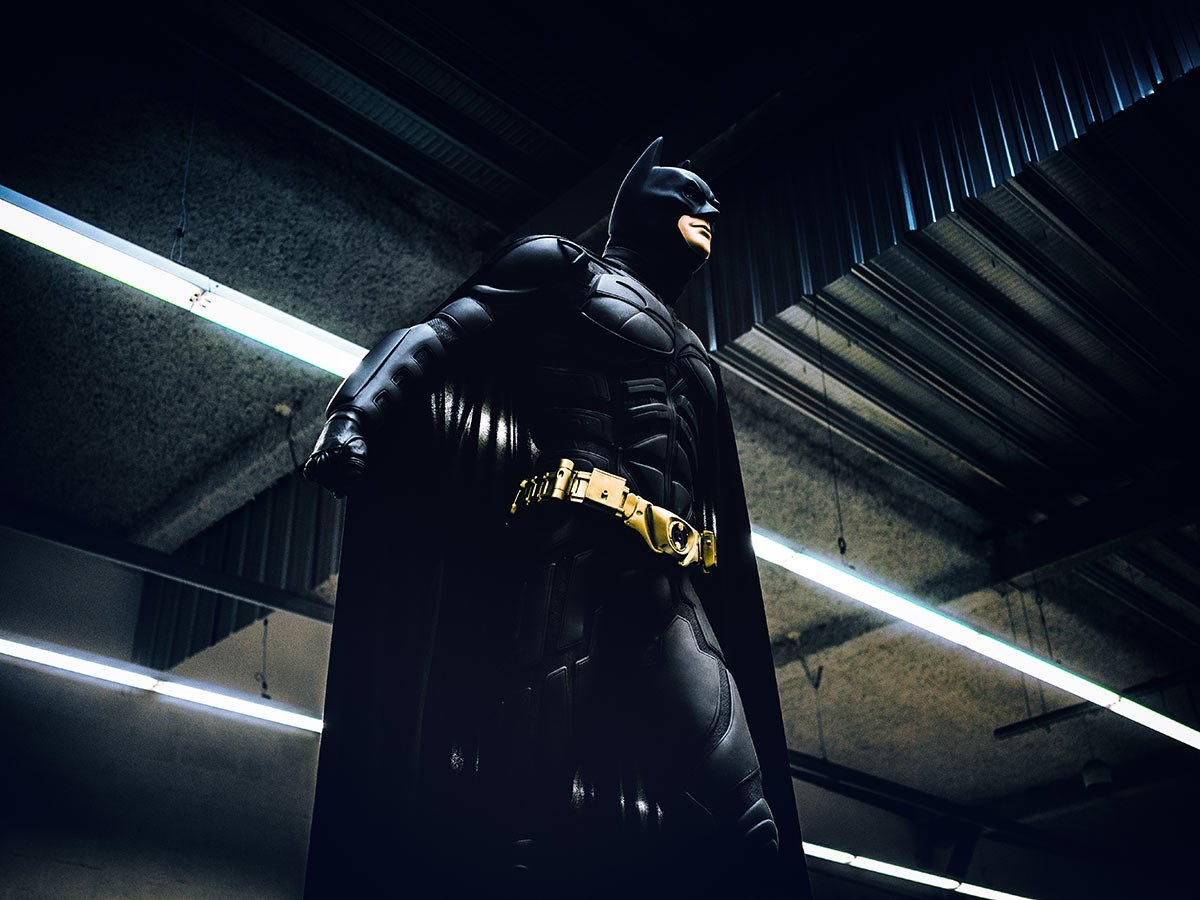 Batman standing with a clenched fist