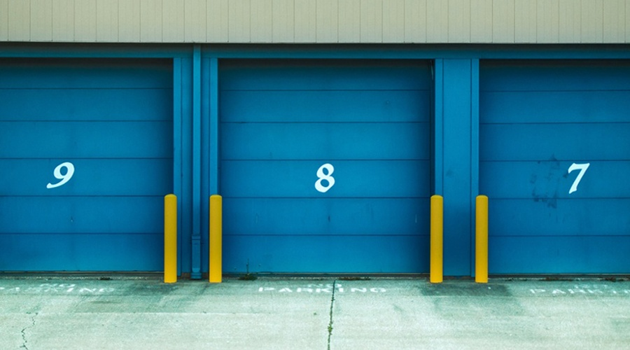 Blue storage garages numbered seven, eight and nine
