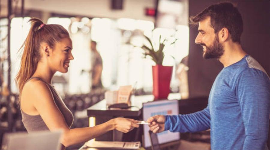 man-woman-gym-check-in-social