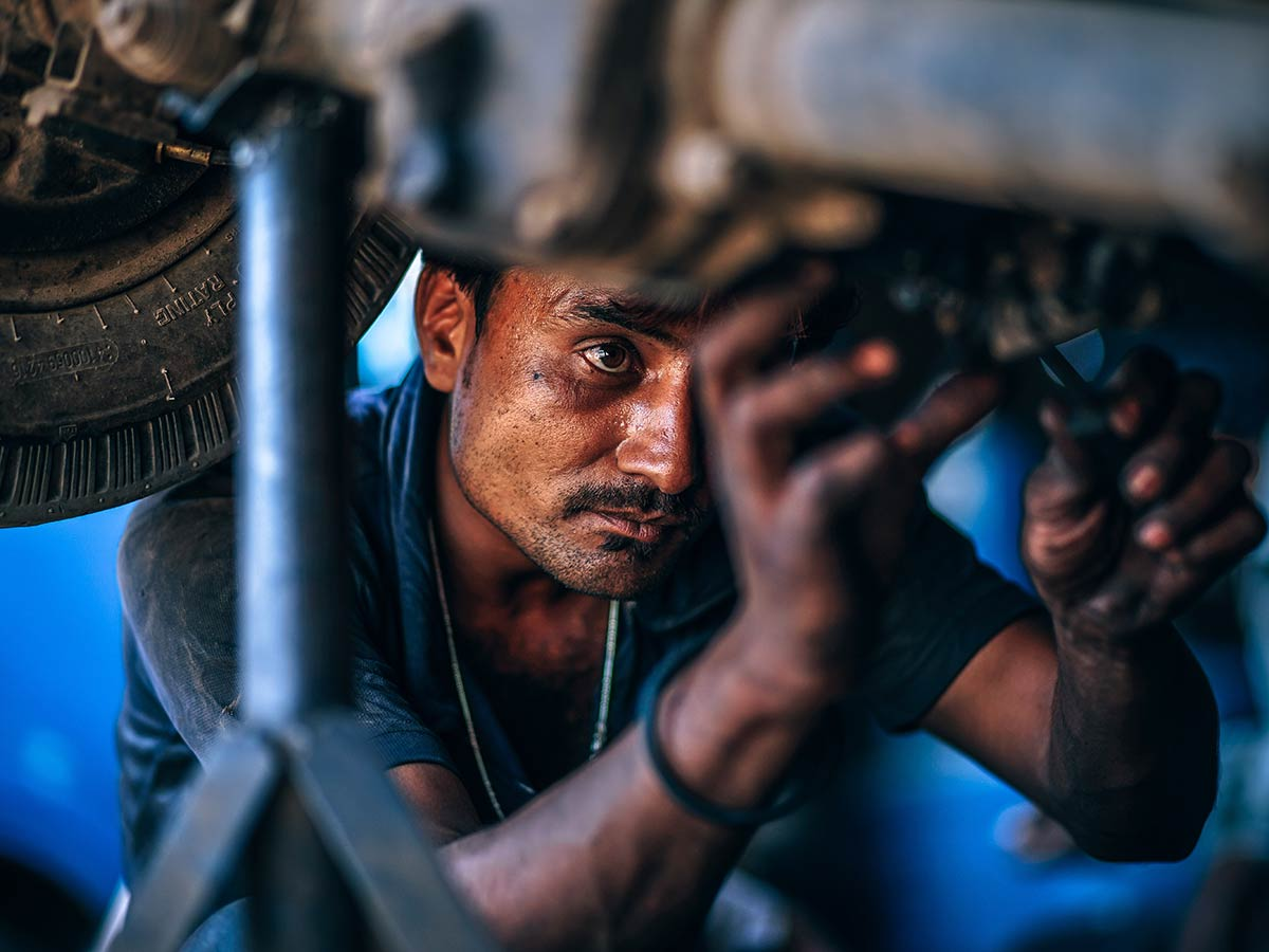 Mechanic doing repairs under the car