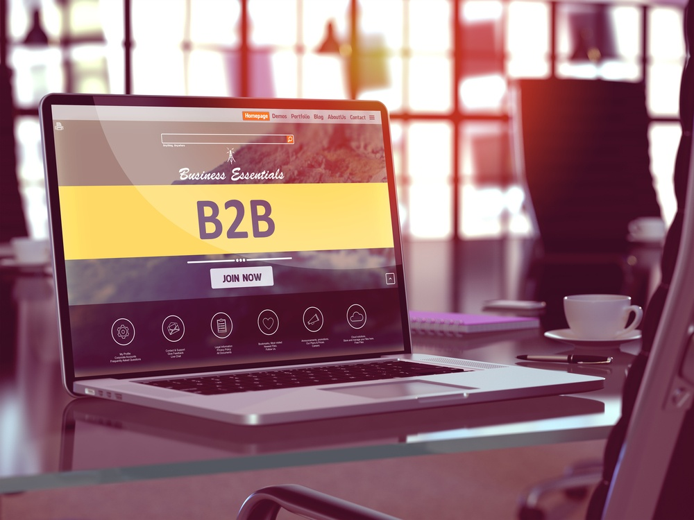 B2B - Business to Business - Concept - Closeup on Laptop Screen in Modern Office Workplace. Toned Image with Selective Focus. 3d Render..jpeg