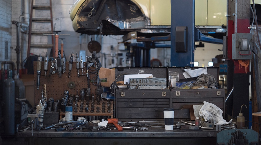 Work bench filled with auto repair tools at an auto shop