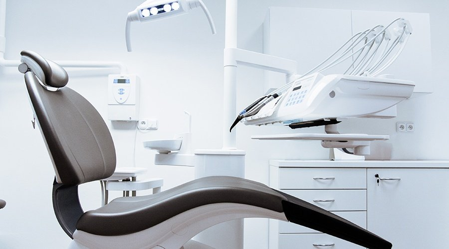 Black and white dental chair in an exam room