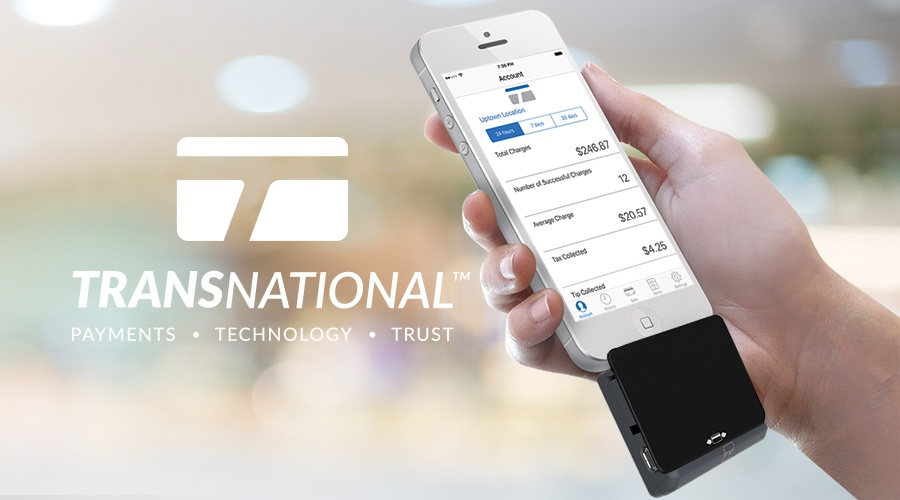 Hand holding a smartphone with TransNational Payments mobile payments app and card reader