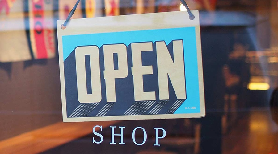 Open sign hanging inside the store window