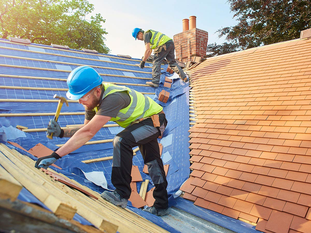roofer-installing-shingles-on-the-roof