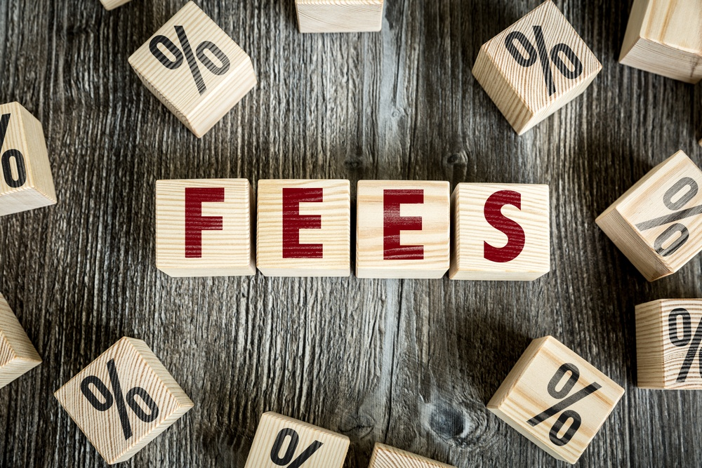 Credit card processing fees what small business owners need to know word fees spelled out on wooden cubes colourmoves